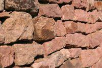 Bereken de kosten van een natuurlijke stenen muur rechts