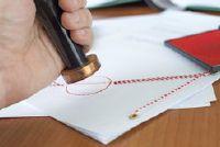 Verschil: notarieel bekrachtigen en openbare attest - Mededelingen