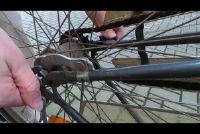 Stel de ketting spanning wanneer de fiets - hoe het werkt