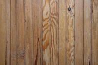 Hechten aan de muur een houten paneel - hoe het werkt