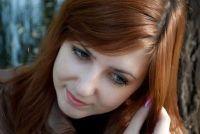 Rood haar en blauwe ogen - type-specifieke make-up tips
