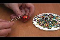 Broche zelf maken - knutselen met kroonkurken