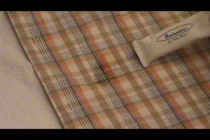 Verwijder kaarsvet uit kleding en textiel